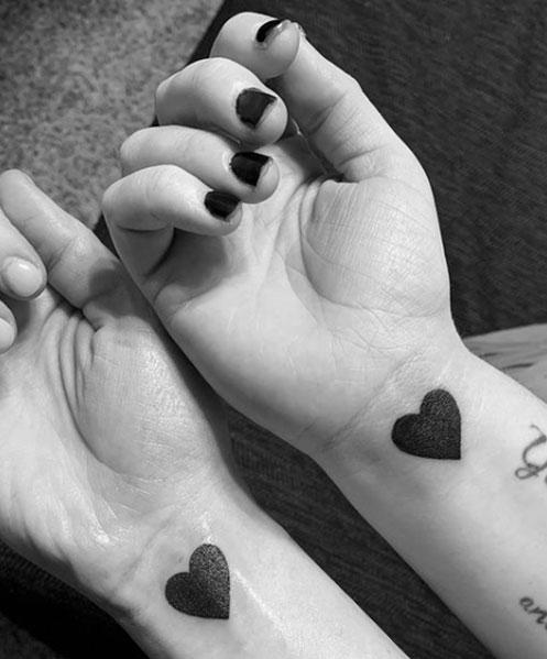 Tattoo hartjes pols