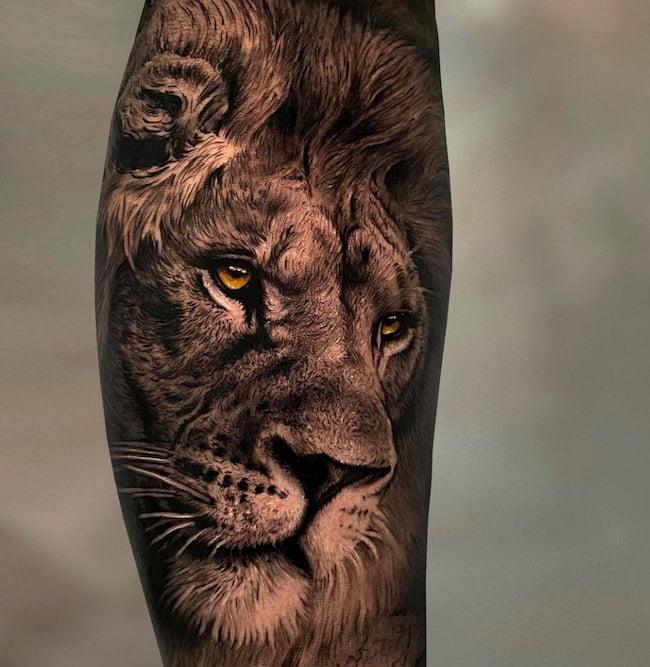 tattoo-arm-leeuw