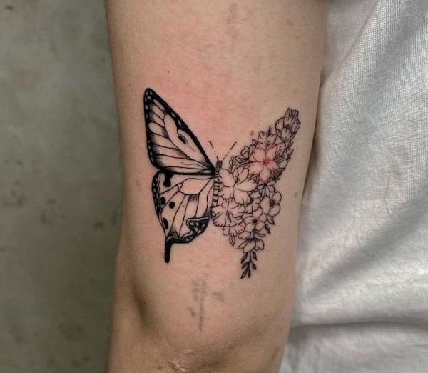tattoo vlinder bovenarm achterkant